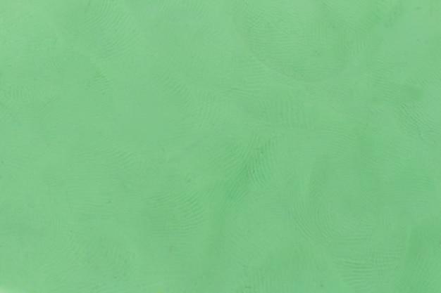 Fondo strutturato verde della plastilina