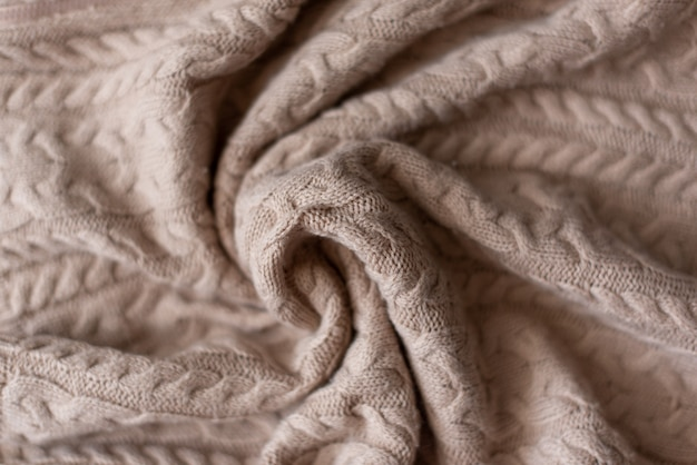 Fondo tricottato del maglione, struttura con lo spazio della copia