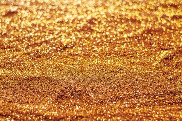 Fondo vago bokeh arancio astratto leggero di scintillio