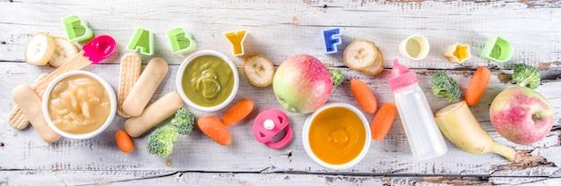 Fondo variopinto dell'insegna della purea degli alimenti per bambini