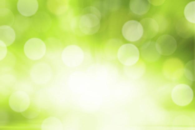 Fondo verde vago dell'estratto del bokeh di pendenza di verde