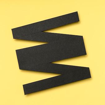 Forma lineare geometrica nera astratta su fondo giallo