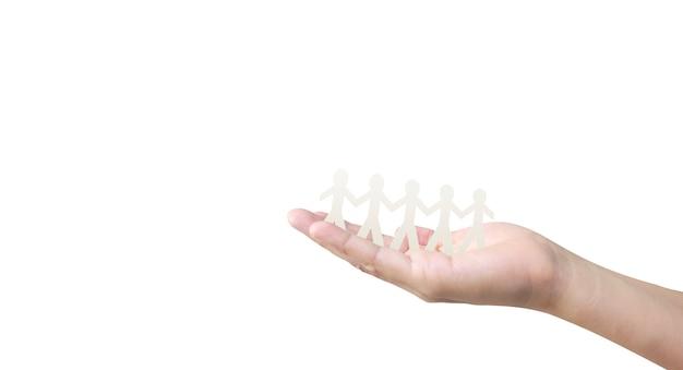 Forma umana in carta tagliata a mano a mano o agita mano nella mano