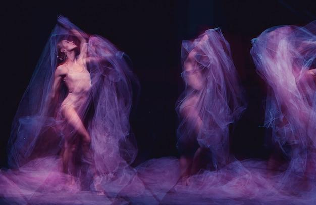 Foto come arte - una danza sensuale ed emotiva della bellissima ballerina attraverso il velo