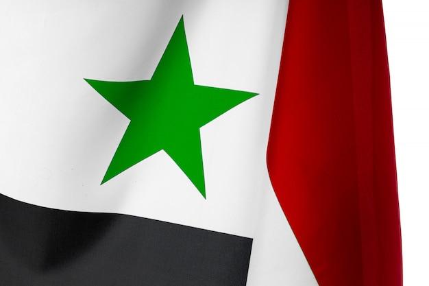 Foto della fine della bandiera della siria del tessuto su