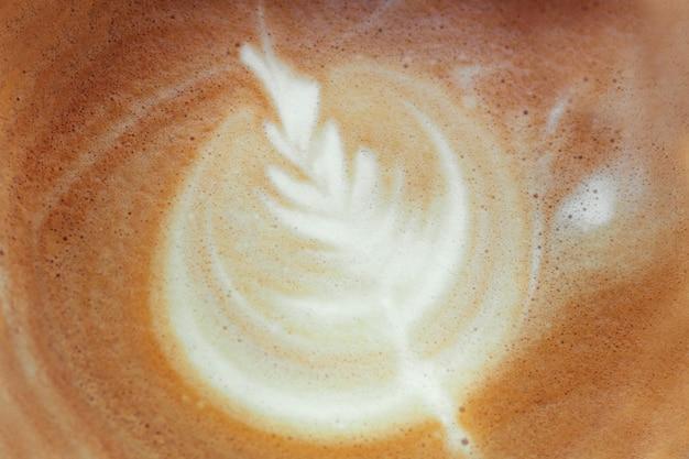 Foto di close-up di caffè. latte art, rosetta, cappuccino al caffè