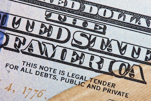 Foto macro dettagli cento dollari di conto.