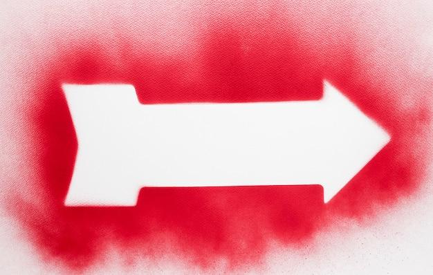 Freccia bianca piatta con contorno rosso spruzzato