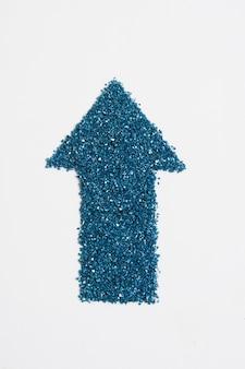 Freccia blu glitterata rivolta verso l'alto