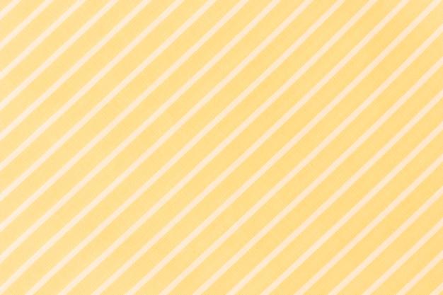 Full frame di linee diagonali bianche su sfondo giallo