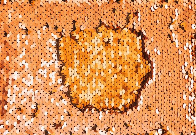 Full frame di sfondo dorato con paillettes