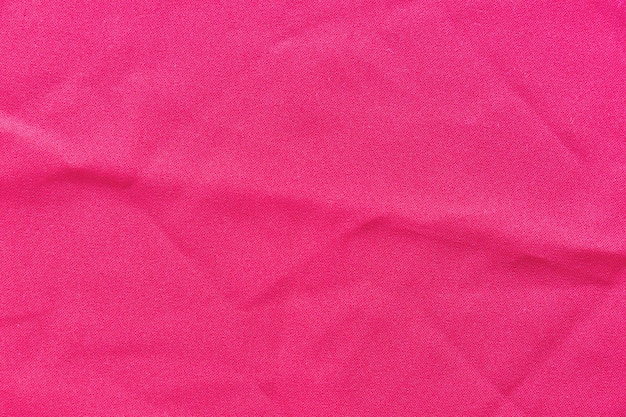 Full frame di sfondo rosa tessuto
