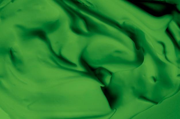 Full frame di sfondo verde brillante struttura crema