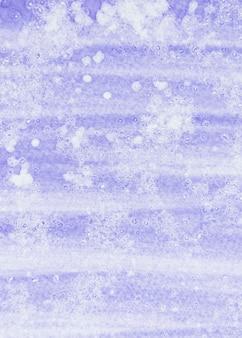 Full frame di viola e bianco acquerello strutturato sullo sfondo