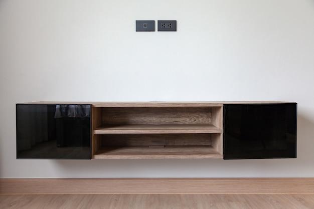 Gabinetto della tv nella stanza interna contemporanea vuota moderna