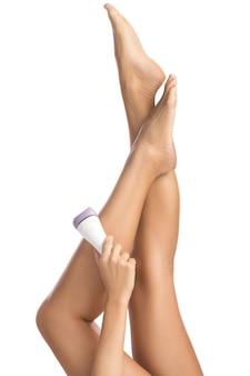 Gambe ed epilatore femminili