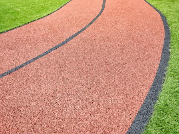 Gamma curva della pista di atletica leggera. sfondo di pista da corsa.
