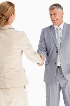 Gente di affari felice che agita le mani