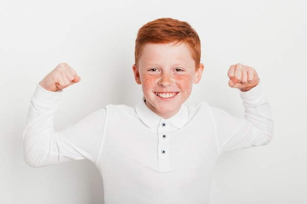 Ginger boy doing strong gesture