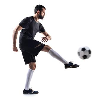 Giocatore di palla uomo di calcio giocare