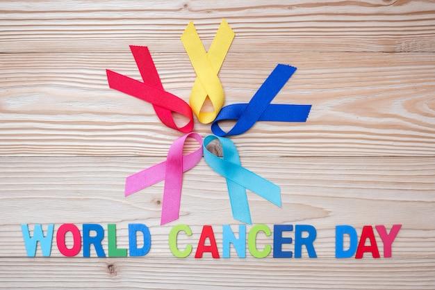 Giornata mondiale del cancro (4 febbraio). nastri colorati di consapevolezza