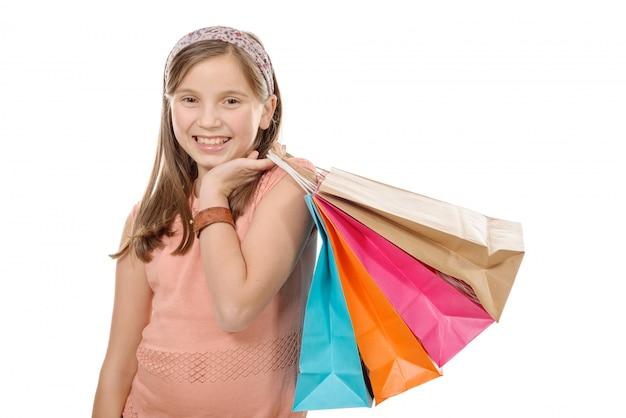 Giovane adolescente tenere con la borsa della spesa