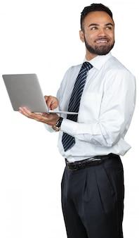 Giovane computer portatile della holding dell'uomo d'affari