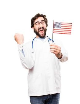 Giovane medico con una bandiera