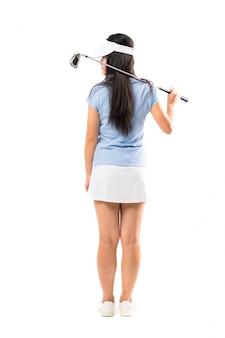 Giovane ragazza asiatica del giocatore di golf sopra la parete bianca isolata