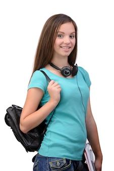 Giovane studente sorridente felice con la sua borsa di scuola.
