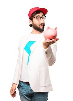 Giovane uomo d'affari pazzo con una banca piggy