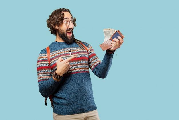 Giovane uomo hippie con un portafoglio