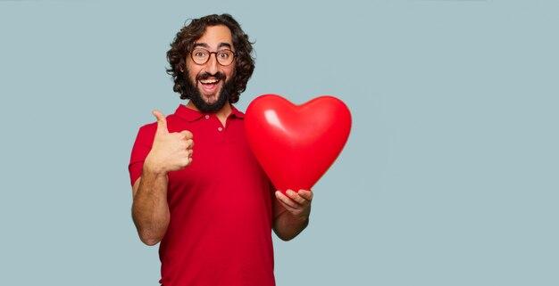 Giovane uomo pazzo concetto di san valentino