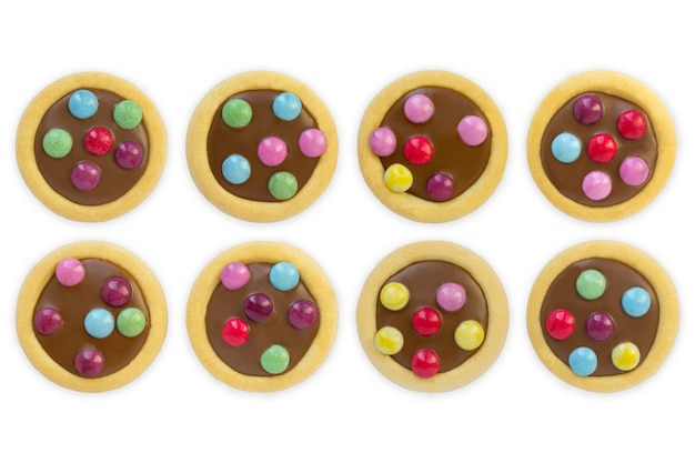 Glassa variopinta dei biscotti, fondo bianco isolato