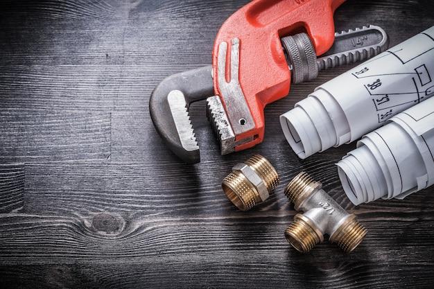 Gli impianti idraulici della chiave inglese hanno rotolato i piani di costruzione