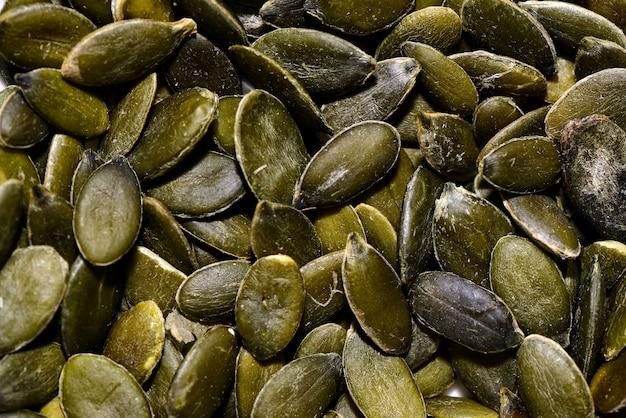 Gli ingredienti alimentari si chiudono su - i semi di zucca.