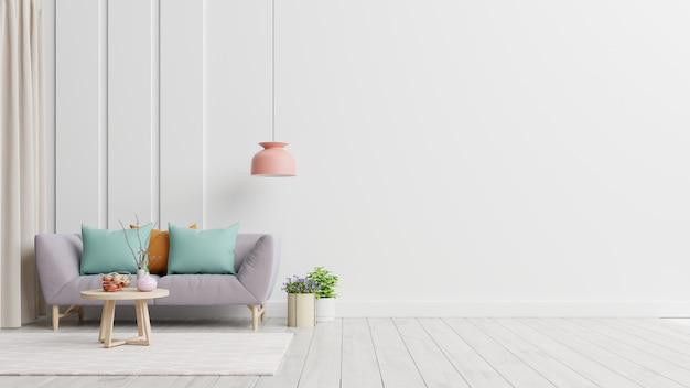 Gli interni luminosi e accoglienti del soggiorno moderno dispongono di divano e lampada con parete bianca.