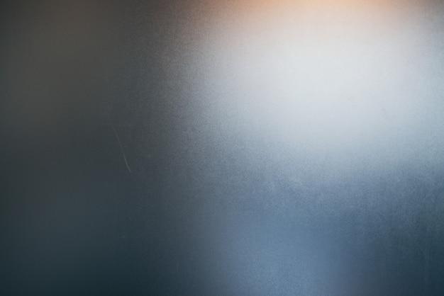Gli sfondi astratti, le caratteristiche della luce colpiscono la superficie, causando rumore e consistenza del grano