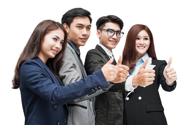 Gli uomini e le donne di affari stanno mostrando i pollici su concetti che sono d'accordo
