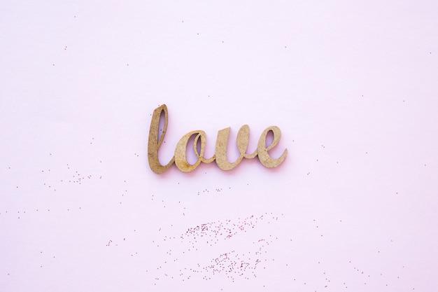 Glitter vicino alla scrittura d'amore
