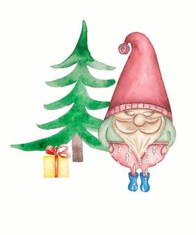 Gnomo sveglio con il regalo di inverno vicino all'albero di natale isolato