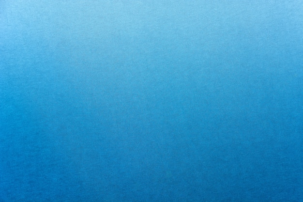 Gradiente blu scuro del blu scuro dell'indaco tinto sulla struttura del panno di cotone per fondo