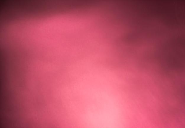 Gradiente di luce fumo astratto rosa su uno sfondo scuro