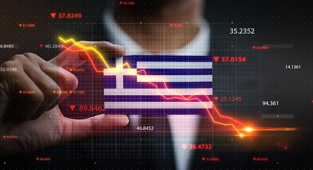Grafico che cade davanti alla bandiera della grecia. concetto di crisi