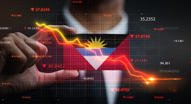 Grafico che cade davanti alla bandiera di antigua e barbuda. concetto di crisi