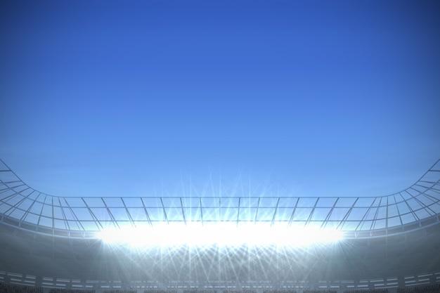 Grande stadio di calcio con faretti sotto il blu intenso