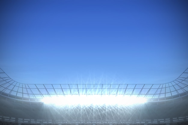 Grande stadio di calcio sotto un cielo blu brillante