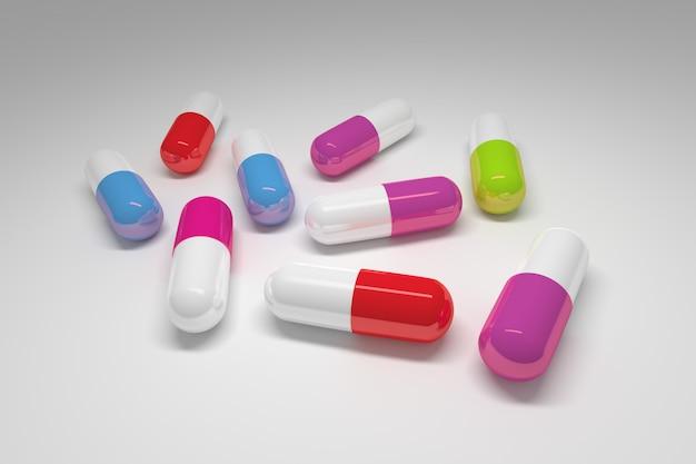 Grandi pillole mediche con tappi colorati su bianco