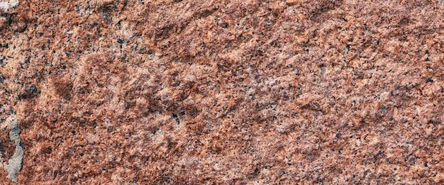Granito di fondo con piccole macchie bianche e nere su tutta la superficie