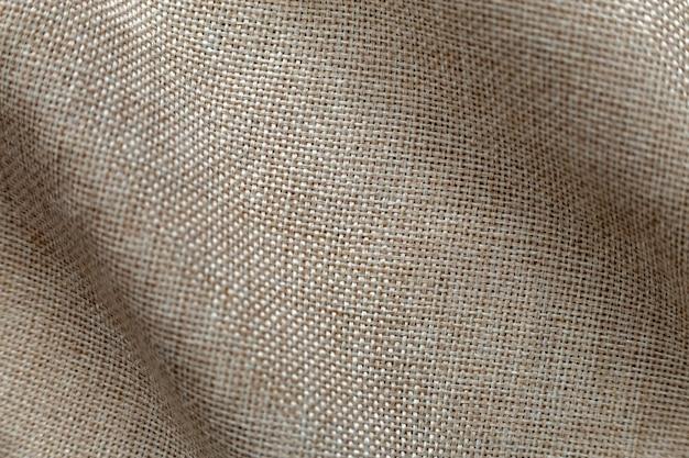 Grigio beige tela di lino sfondo della superficie. design della tela di sacco, tessuto di cotone ecologico, tela flessibile tessuta alla moda.